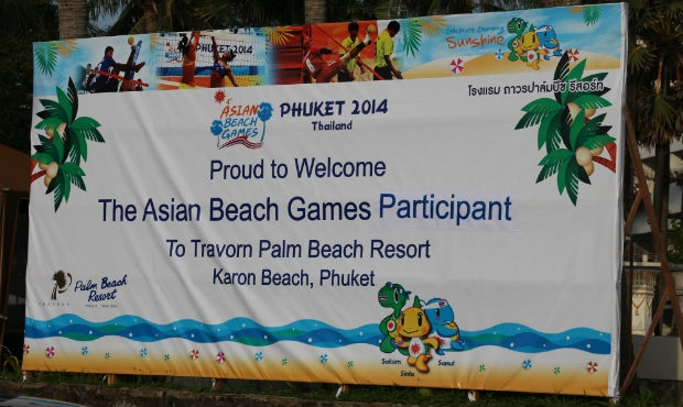 People with red flags, sambo jacket kurtkas, golden sand and other tints of sambo tournament in the program of Asian Beach Games – 2014