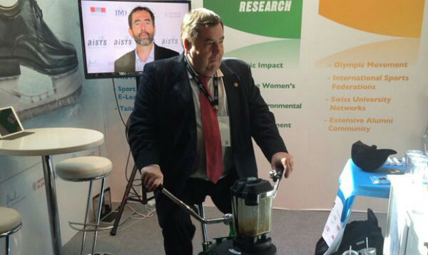 FIAS President Vasily Shestakov cycling at the stand of Inernational Academy of Sports Science and Technology (AISTS) at 2014 SportAccord Convention